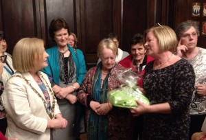 Jessica (Marlay Guild President) presents a gift of ICA books and bag made , by Craft Group to Lord Mayor Críona Ní Dhálaigh.